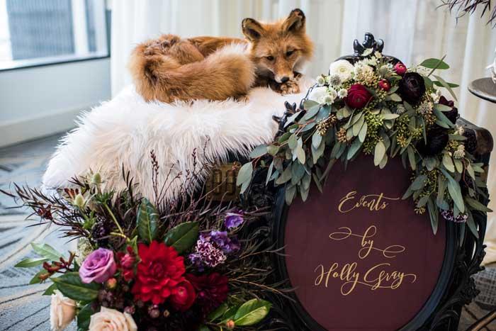 Taxidermy fox and dark forest florals.