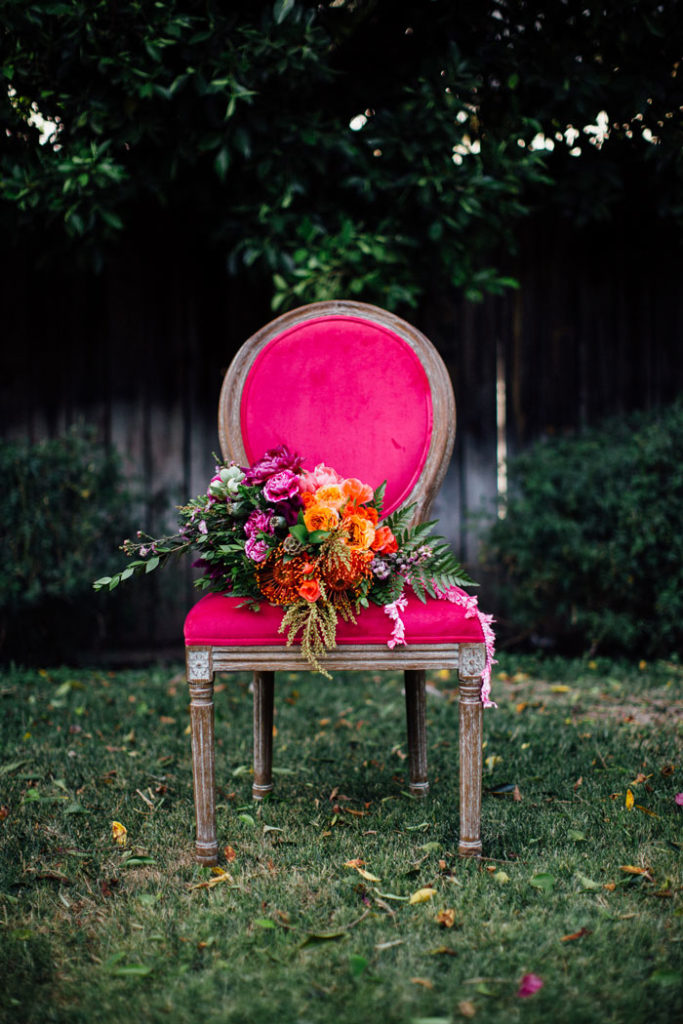 Colorful bouquet on pink vintage chair.