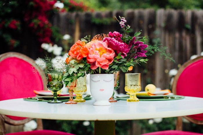 Bright tabletop with cute face vase!
