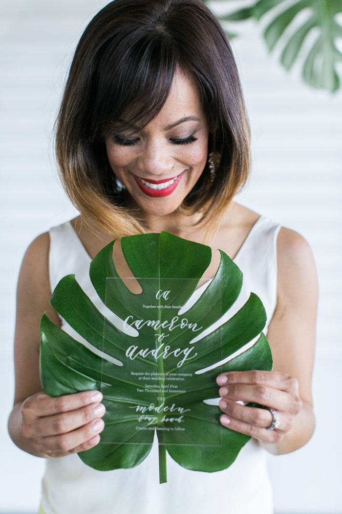 acrylic wedding invitation with monstera leaf