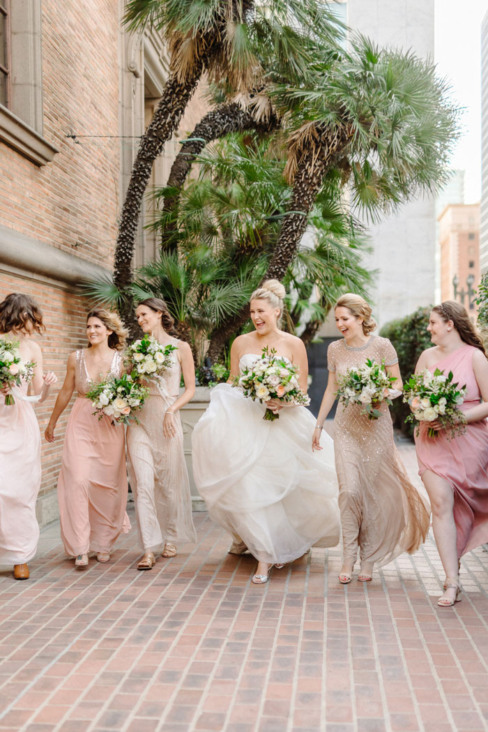 Blush and gold bridesmaids with beautiful neutral garden rose bouquets.