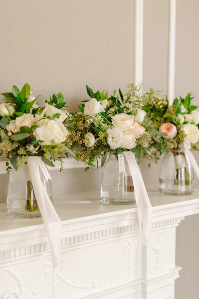 Blush bridal bouquets, boutonnieres, and wedding details.