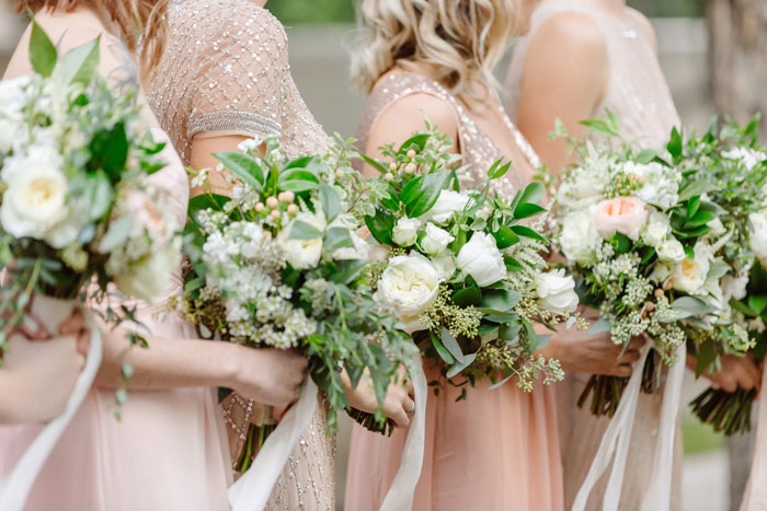Blush + gold bridesmaids with garden fresh bridesmaids bouquets.