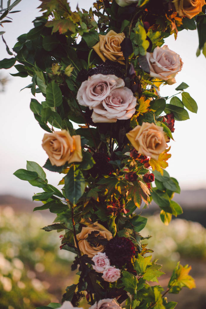 Flower arch detail shot: quicksand and combo roses, salal, ninebark, and maple