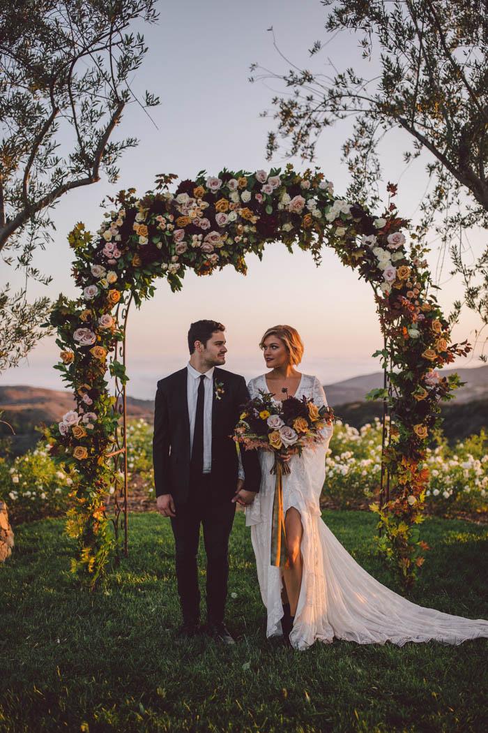 Lush and bohemian fall wedding arch