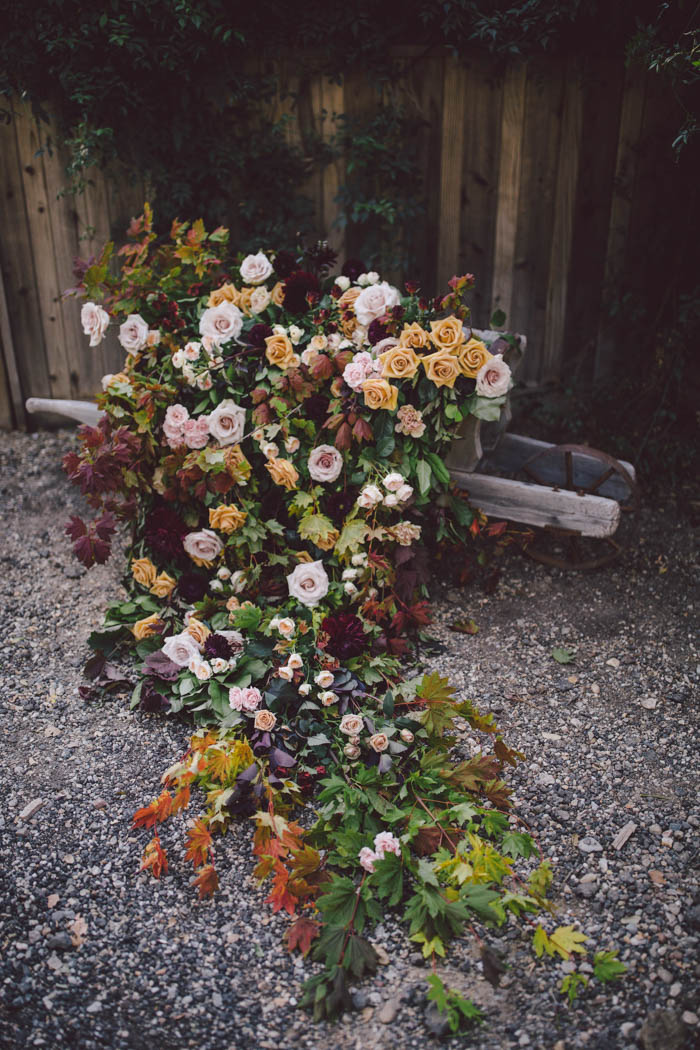 Rustic Wheel Barrow with cascading roses and fall leaves