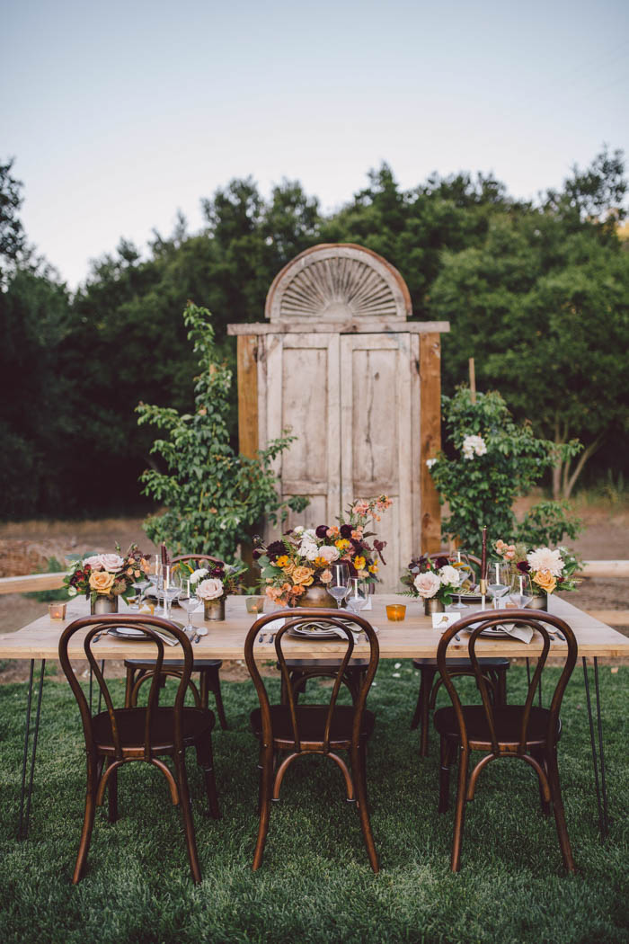 Fall tablescape set against rustic wooden doors at Stonewall Ranch, Malibu