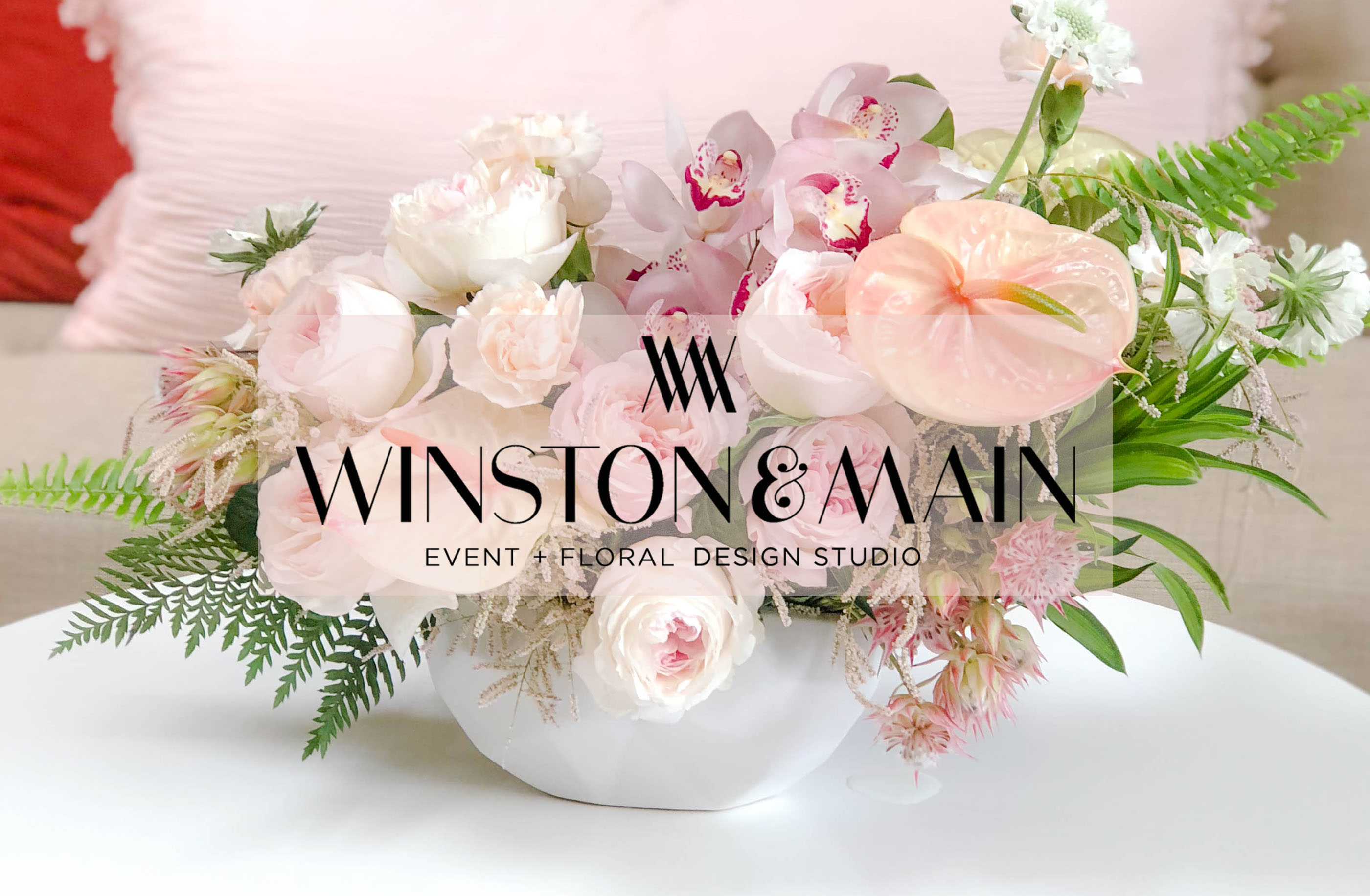 Winston & Main, Blush and Ivory Centerpiece with garden roses, anthurium, and fern.