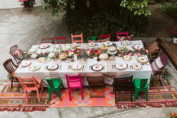 A colorful and bohemian garden party, afternoon tea, or wedding tablescape
