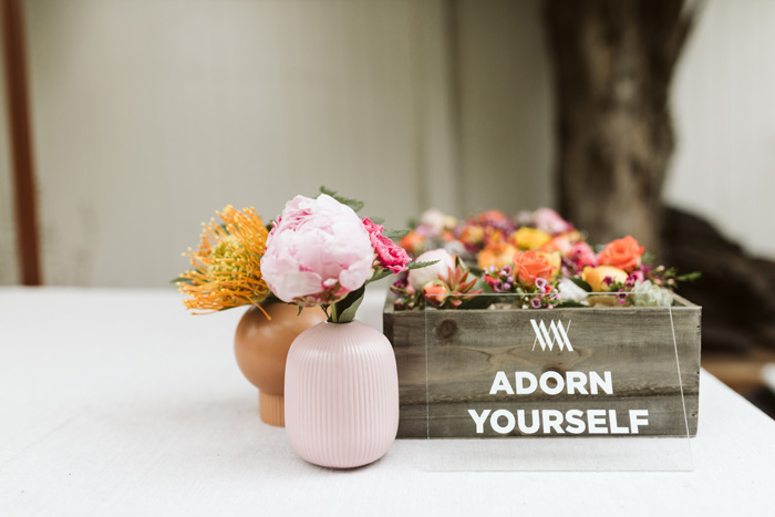 "Winston & Main ""Adorn Yourself"" acrylic sign and modern brass wrist corsages"