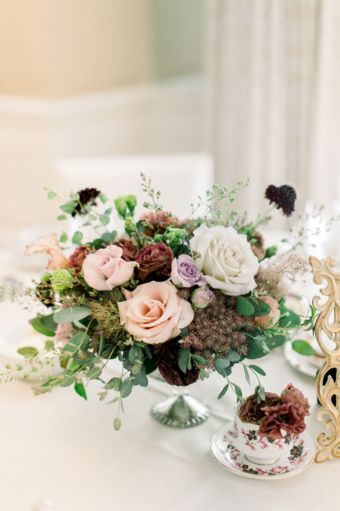 Blush, mauve, and burgundy wedding centerpiece