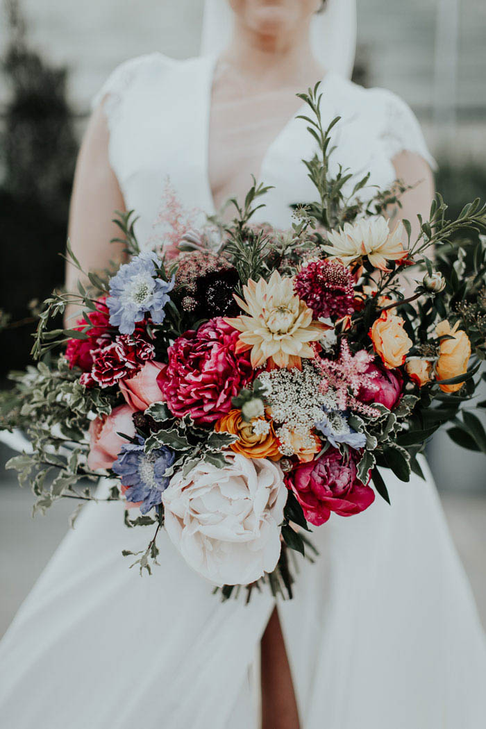 Lush bridal bouquet full of peonies, dahlias, and organic greenery.