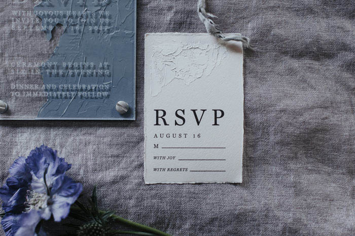 Unique acrylic invitations styled with scabiosa flower