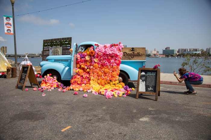 Tabitha Abercrombie of Winston & Main snaps a pic of her colorful floral installation for Don Julio Tequila