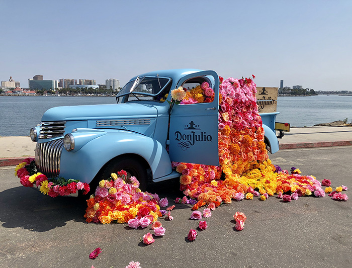 Colorful flower installation on the vintage blue Don Julio Tequila truck