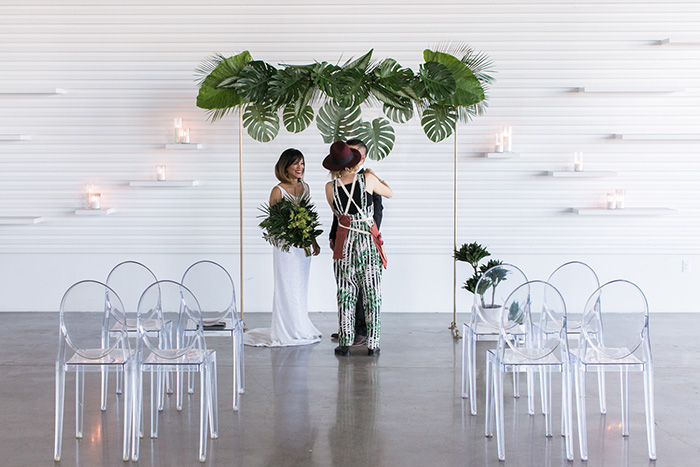Tabitha Abercrombie of Winston & Main makes some behind the scenes adjustments to groom's boutonniere before shooting for Tropical Wedding Editorial.