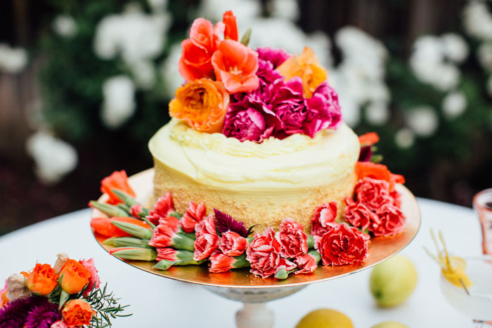 Supermarket cake with lots of festive flowers