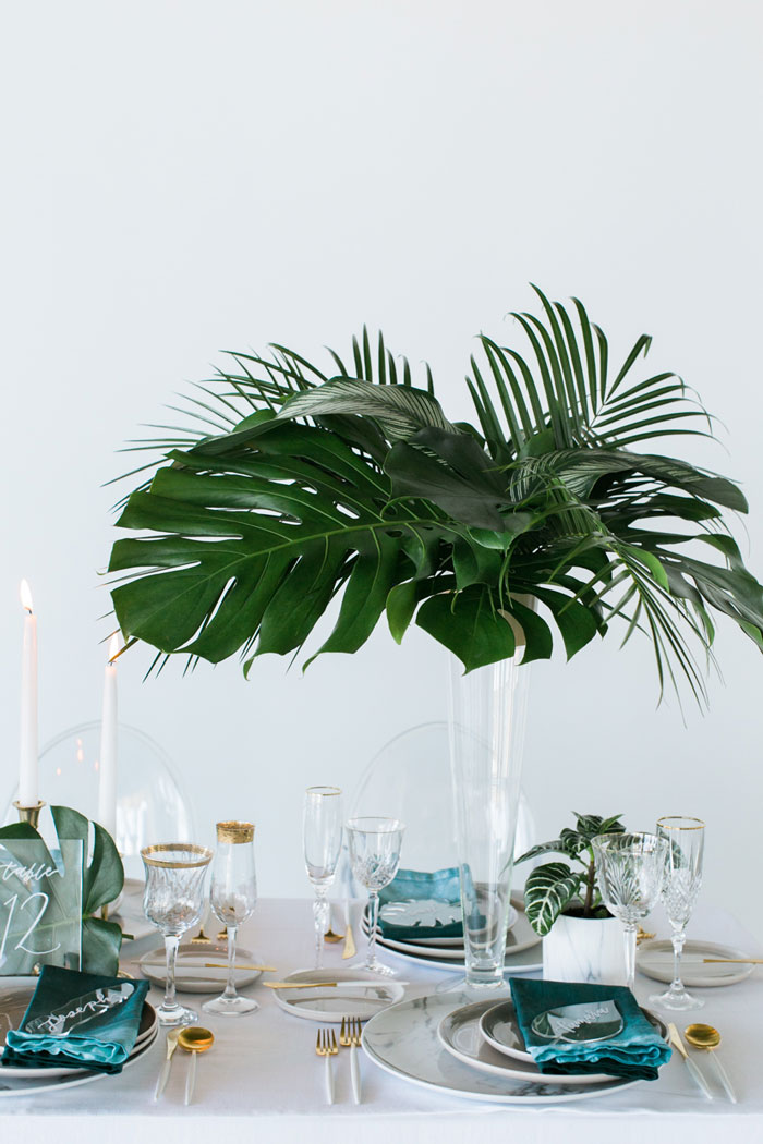 Tall tropical wedding centerpiece.