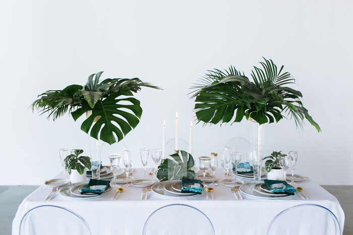 Modern, minimal, and tropical wedding table inspiration.