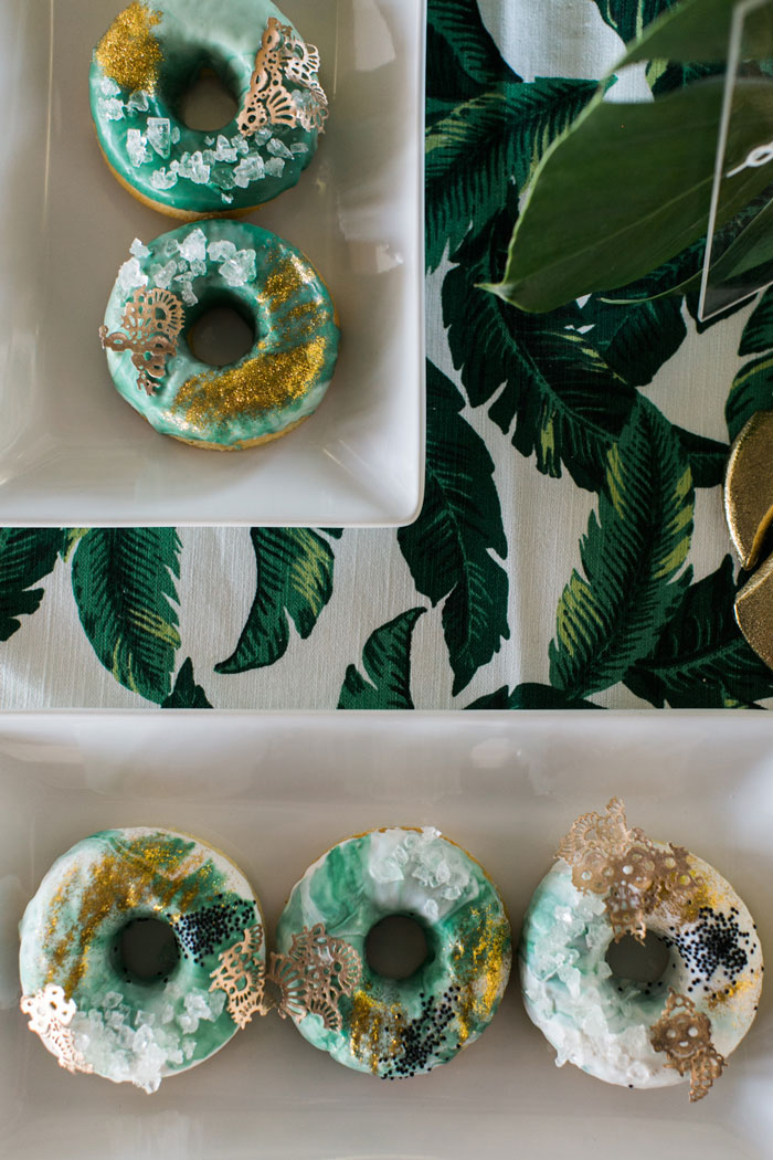 Tropical wedding desserts- gold leafed donuts.