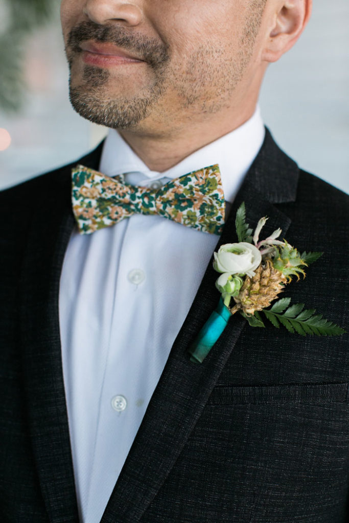 tropical bridal bouquet and tiny pineapple boutonniere.