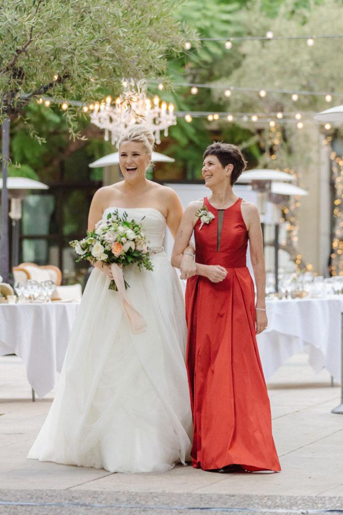 Mom walking bride down the aisle.