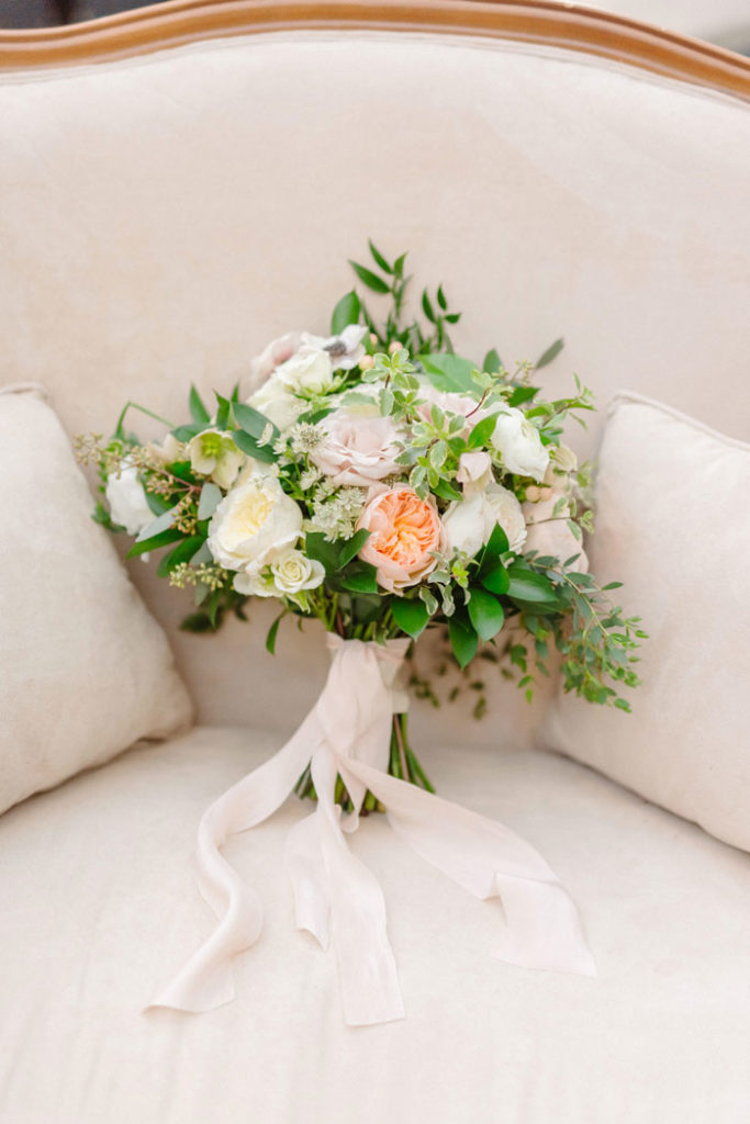 Beautiful cream & blush bridal bouquet featuring a variety of garden roses.