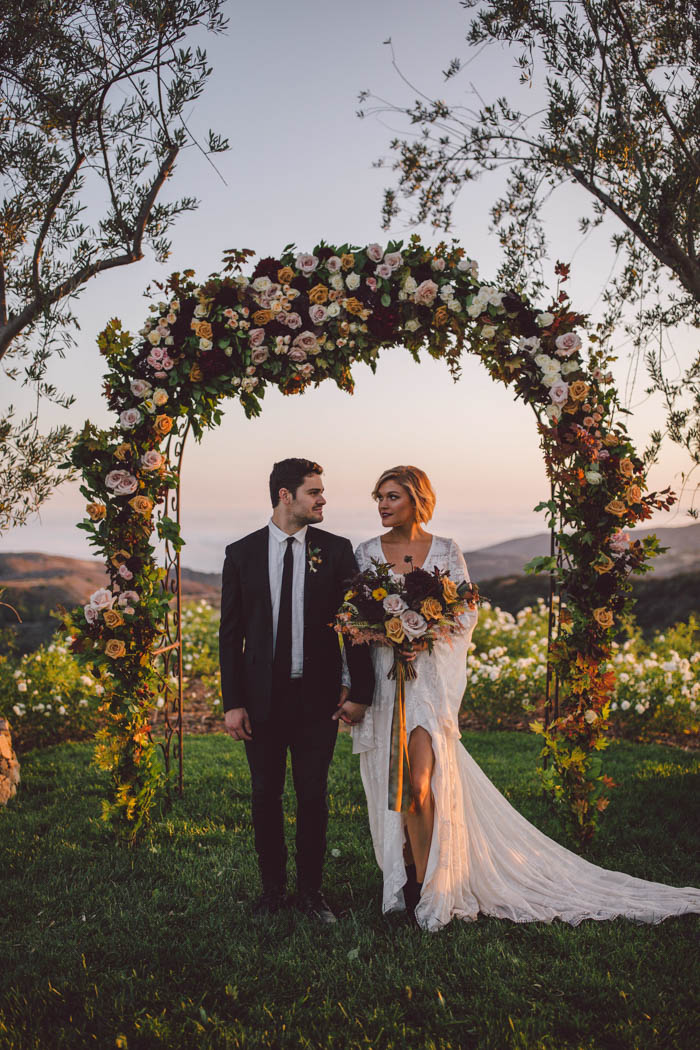 Lush and bohemian fall wedding arch