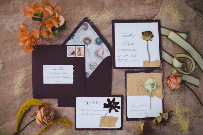 Fall wedding invititation suite in burgundy with pressed flowers and custom envelope liner