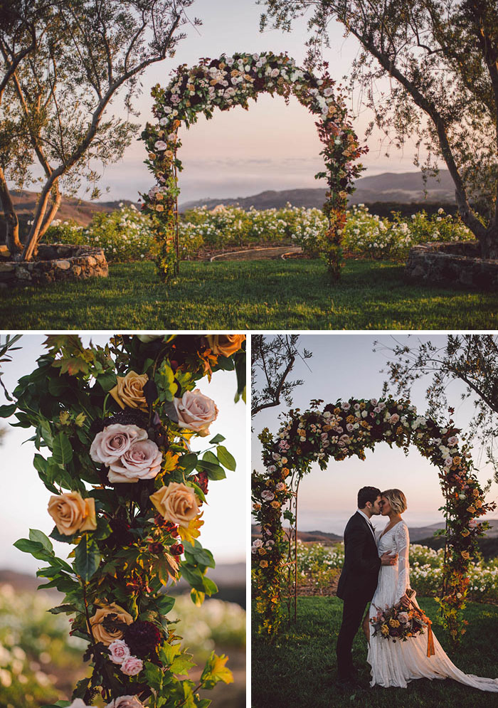 Romantic fall floral arch full of roses and dahlias in shades of blush, berry, burgundy and gold
