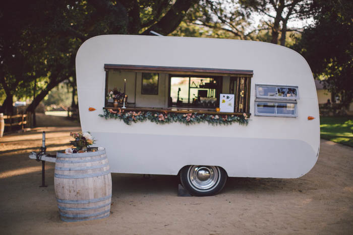 The Old Fashioned Caravan, a delicious fall cocktail, and cocktail signage with pressed flowers
