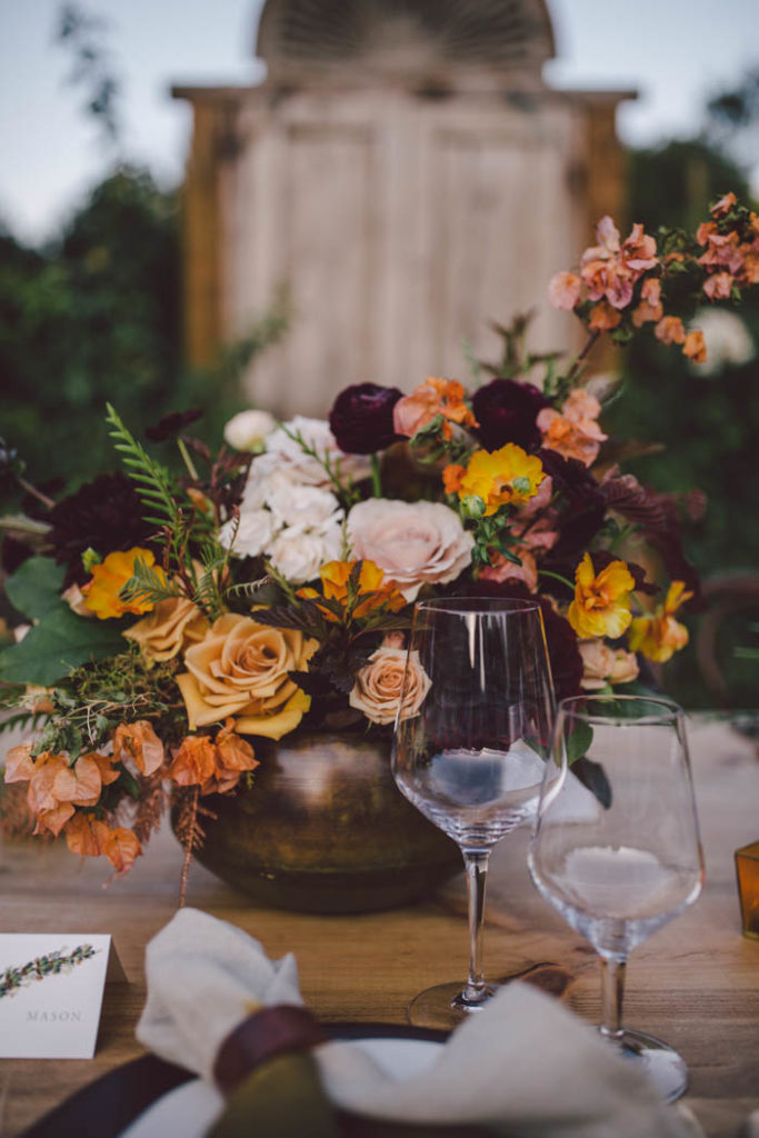 Fall Wedding Centerpiece featuring blush, peach, burgundy and gold flowers