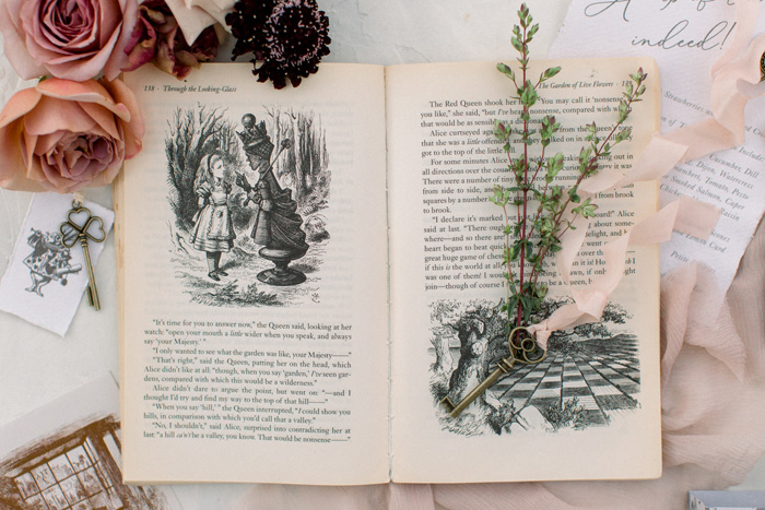 alice in wonderland book & floral flatlay