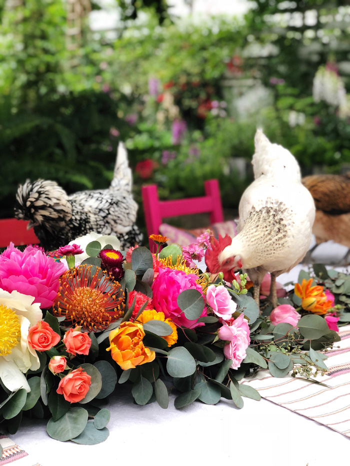 backyard chickens in lush floral garland
