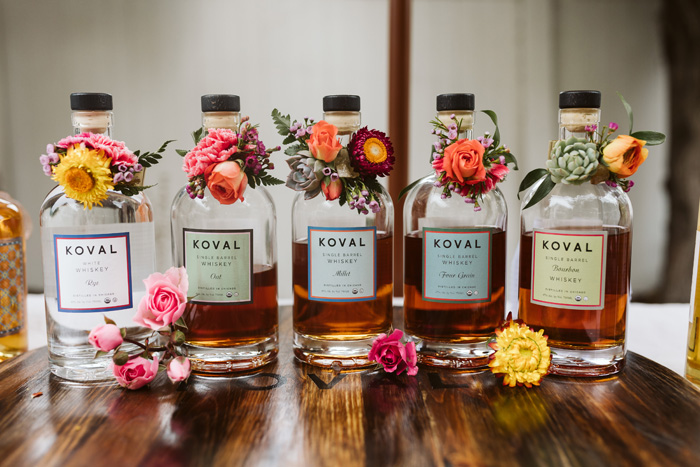 Koval bottles with flower adornments