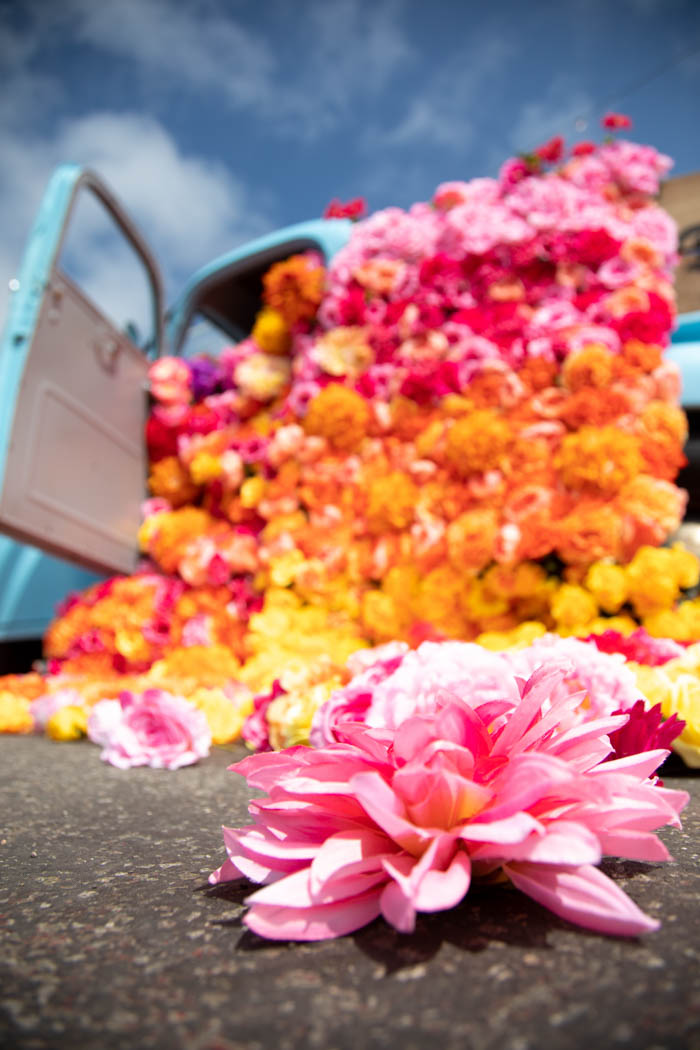 Bright floral blanket spills out of vintage blue chevy for Don Julio Tequila activation.