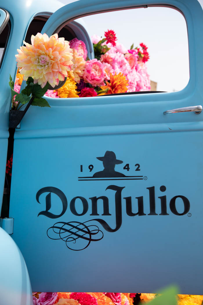 Vintage blue Chevy Don Julio Tequila truck filled with flowers by Winston & Main