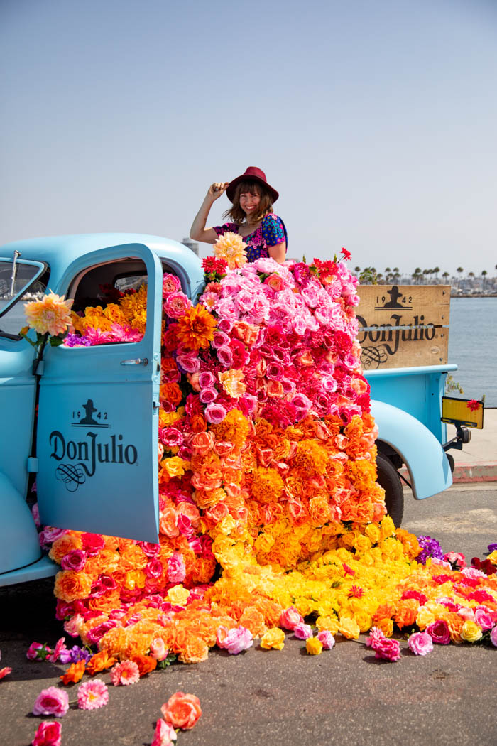 Tabitha Abercrombie of Winston & Main poses with her floral installation for Don Julio Tequila