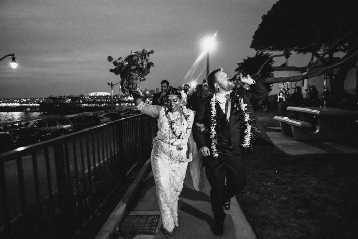A joyful + just married couple lead a second line to their wedding reception!