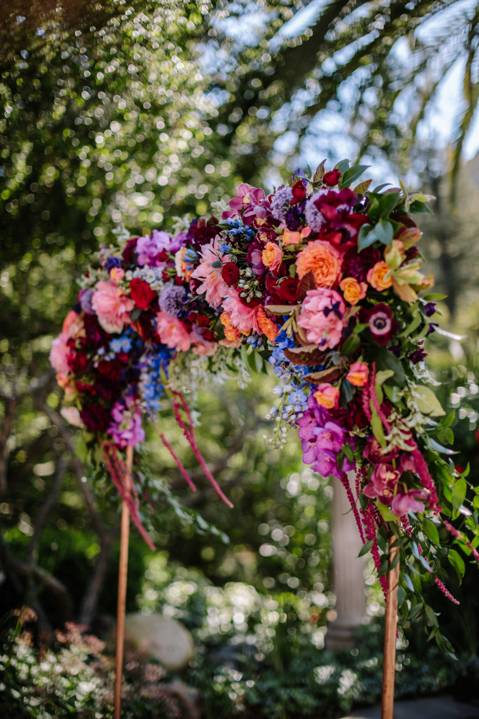 The lush jewel toned floral copper arch designed by Los Angeles florist Winston and Main.