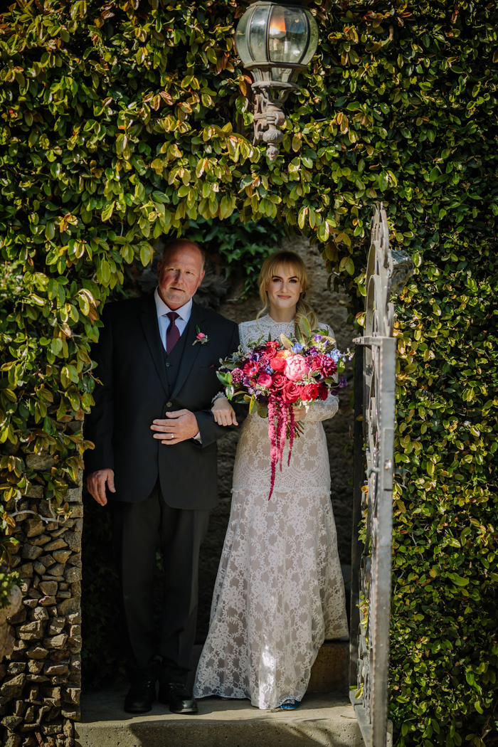 The bride and her father walk down the aisle at her Houdini Estate wedding in Los Angeles.