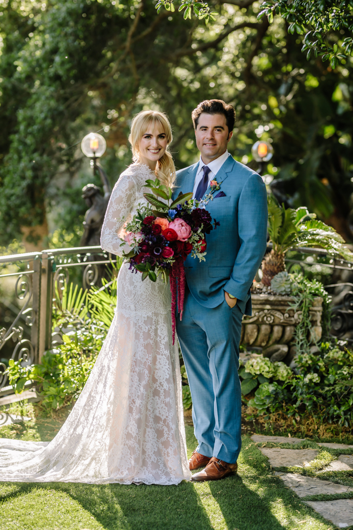 Our sweet Los Angeles couple at their Houdini Estate wedding with jewel tone flowers by Winston and Main.