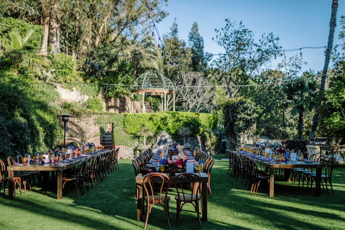 The Houdini Estate wedding reception with jewel toned flower arrangements designed by LA florist Winston and Main