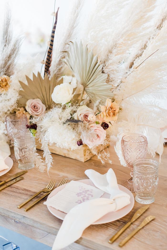 Ethereal bohemian table arrangement featuring natural tones and dry flowers.