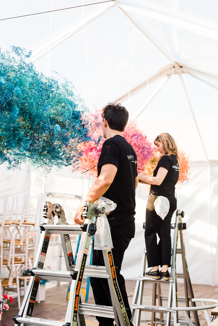 Team Winston & Main installs 21 feet of floral clouds.