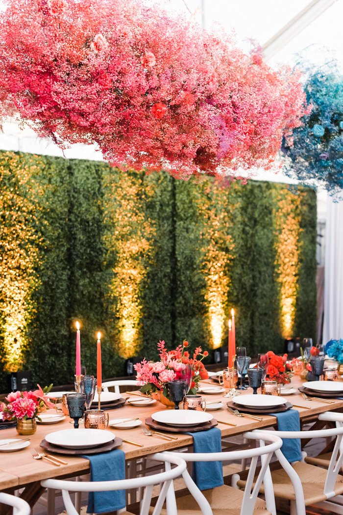 Dyed & painted babies breath clouds hanging over long tables at intimate & colorful birthday celebration.