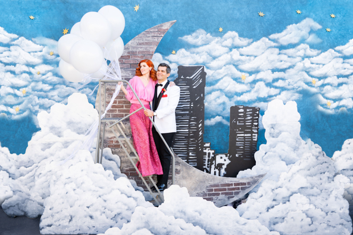 I Love Lucy inspired wedding featuring a beautiful hand painted backdrop and balloon bouquet.