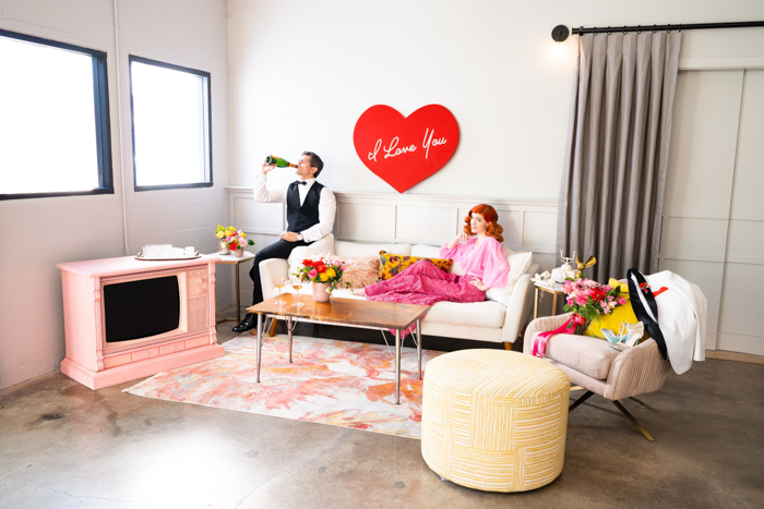 I Love Lucy inspired photoshoot featuring a pink television and bold bloom by Winston & Main.