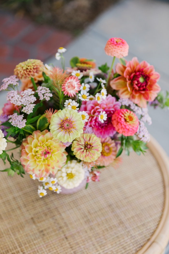 A colorful summer arrangement featuring local dahlias & zinnias in shades of yellow, peach, coral, pink and more, by Winston & Main.