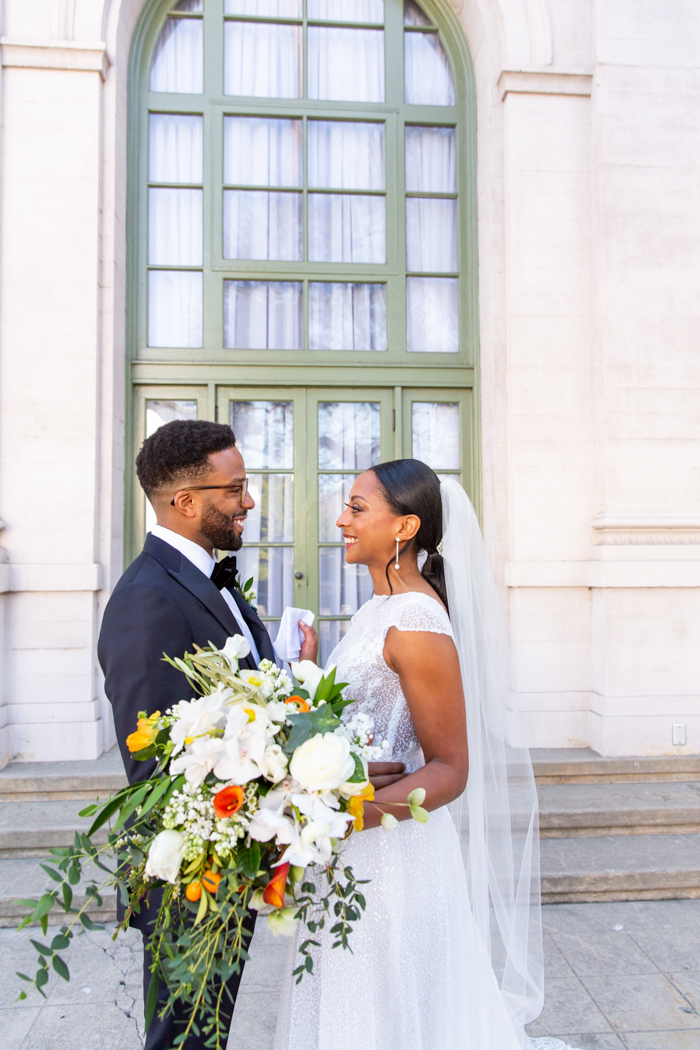 A beautiful cascade bouquet in white, green, and orange for our Leap Day Wedding at the Ebell Los Angeles, as featured on Martha Stewart.